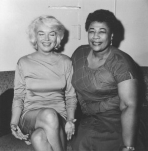 actress marilyn monroe and singer ella fitzgerald sitting side by side