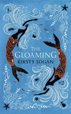 A light blue background on which two mermaids dance, following each other in a circle. Their decorated tails are red and black. In their flowing hair one can spot small objects, such as a pair of scissors, a beetle, and a chicken wishbone. Star fish and algae grow on the upper right hand and lower left hand corners of the cover, white like the mermaid's hair.